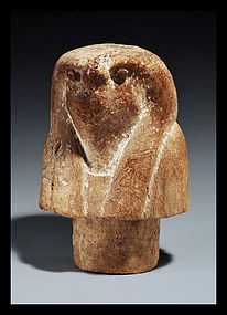 AN ANCIENT EGYPTIAN WOOD CANOPIC STOPPER