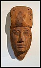AN ANCIENT EGYPTIAN WOOD MASK FROM A SARCOPHAGUS