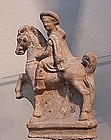 AN ANCIENT GREEK TERRACOTTA EQUESTRIAN FIGURE