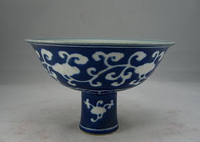 A Rare Ming Dynasty White on Blue Ground Stem-Bowl