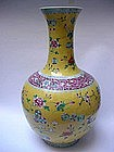 YELLOW GROUND FAMILLE ROSE BOTTLE VASE