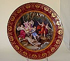 A Vienna Ruby-Ground Porcelain Charger