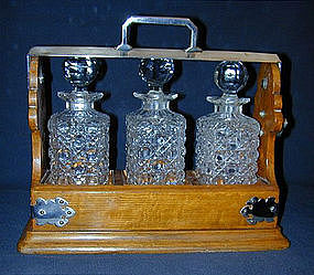 A Victorian Oak and Silverplate Tantalus