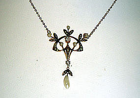 An Art Nouveau Gold, Diamond And Pearl 