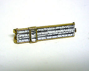 A Slide Rule Tie Clip With Magnifying 