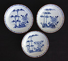 Set of three Kangxi blue & white and Batavia brown saucer plates