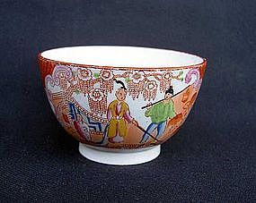 An English transfer-printed and painted tea bowl