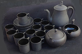 Wedgwood black basalt coffee pot, cans and saucers