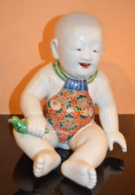 Japanese Satsuma Porcelain Sculpture of a Baby Boy
