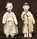 Korean Antique Dolls with Warm Faces and Bent Posture
