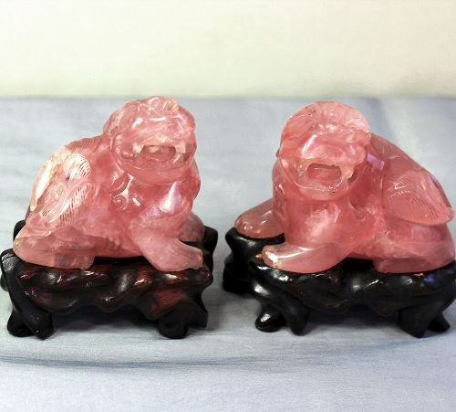 Chinese Rose Quartz Foo Lions on hardwood stands(pair)