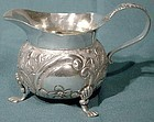 Fine REPOUSSE STERLING FOOTED CREAMER 1900