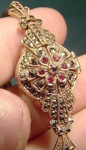 9K ROSE GOLD COVERED LADY'S WRISTWATCH w/ GARNETS