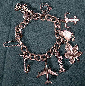 Vintage STERLING CHARM BRACELET with 8 CHARMS