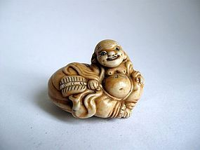 Japanese Hirado Porcelain Netsuke of Hotei, Signed