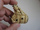 Japanese Antler Ivory Netsuke of Hotei on a Straw Bale