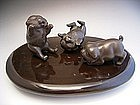 Japanese E 20th century bronze trio of puppies by Kozan