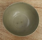 A Rare Five Dynasties Yue Mise Bowl with Bird Motive