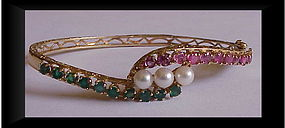14K hinged bangle bracelet, emeralds, rubies, pearls