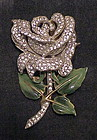 Corocraft sterling rose with enamel leaves brooch