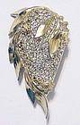 Reja gold tone rhodium pate pave crystal floral brooch