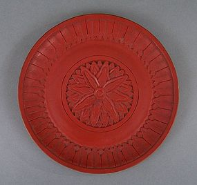 Chinese carved cinnabar saucer dish with chrysanthemum decoration