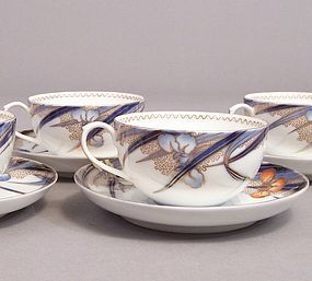 Fukagawa Iris pattern tea cup and 5 3/8 inch saucer