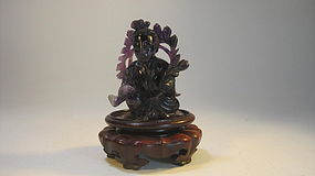 A Beautiful Natural Purple Crystal Rock Guanyin