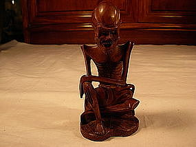 A carved Chinese wood monk