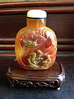 A large carved agate Chinese snuff bottle