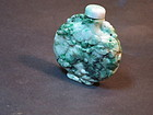 Carved Chinese green jade snuff bottle