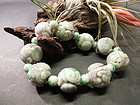 Strands of large carved Chinese motif jadeite beads