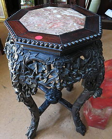 A rosewood flower stand with marble inset