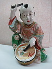 Famille rose -enameled porcelain statue  of a boy