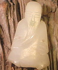 Antique Chinese white jade carving of a longivity god