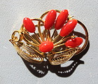 Coral metal brooch