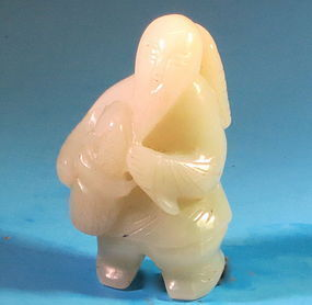 Carved Chinese pale celadon jade fish man