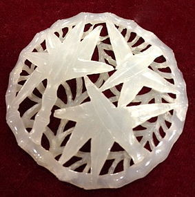 Reticulated white jade circle plaque with bamboo motif
