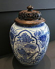 A Chinese blue and white porcelain jar with carved lid