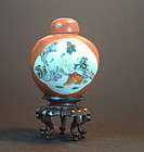 Famille rose enameled  porcelain cover jar rosewood