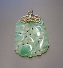 Carved Chinese Jadeite pendant with gold loop