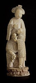 Chinese ivory group of lady and boy