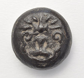 A Round Shaped Talisman Of A Seated Buddha