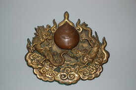 Gilt bronze plaque, dragons and tama, Edo period