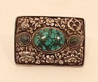 Tibetan Buddhist repousse silver and turquoise buckle