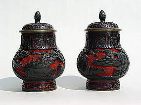 Chinese black over red carved cinnabar lacquer jars